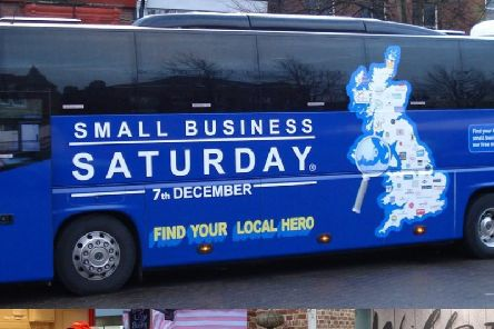 """Small Business Saturday's bus urges residents to """"find your local hero""""."""