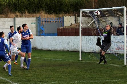 Alex Peterson puts Belper 1-0 ahead. Pics by Mike Smith.