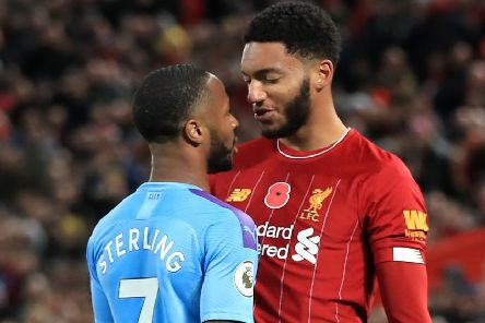 Liverpool's Joe Gomez (right) and Manchester City's Raheem Sterling clash on Sunday