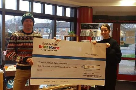 Tim Holloway presents his cheque for 1008.58 to Brian House after his 2018 Christmas lights switch-on.