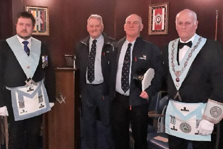 From left: Adam Simpson (Immediate Past Master), Captain David Eccles'(Operations Manager, Fleetwood RNLI), Tony Cowell (Coxswain, Fleetwood RNLI), Barrie Whiteside (Worshipful Master of Onward Lodge