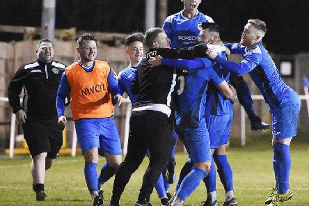 Ryan Riley is at the centre of the celebrations as Squires Gate clinch victory'Picture: ALBERT COOPER