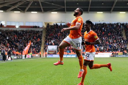 Liam Feeney celebrates his first Blackpool goal against Fleetwood