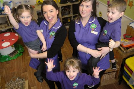 Early years practioners Sharnie Williams and Laura Hill with Lily Percival, Chloe Bamforth and Riley Hawkins, when Treetops was ranked 'outstanding' in March 2016 (Picture: Dan Martino for JPIMedia)