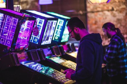 Gamers at one of Arcade Club's other venues