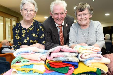 Members of the craft group at Crocus Court have donated knitted blankets to Len Curtis from Donna's Dream House.  He is pictured with Jill Snowball and Vera Lowis