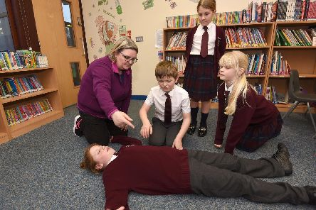 Pupils in year 4 and 5 with teacher Julie Ellershaw learning essential first aid skills.