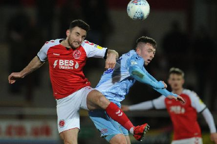 Fleetwood's Lewie Coyle competes for the ball for Jordan Shipley of Coventry