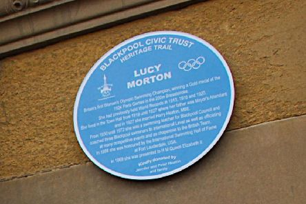 Blue Plaque of Lucy Morton, 1924 Olympic Gold Medal winner, on the Town Hall entrance at Talbot Square.