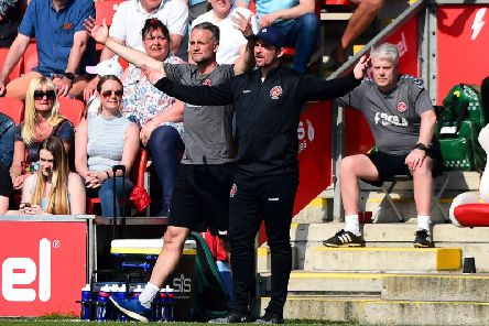 Clint Hill and Joey Barton in the dug out against Peterborough