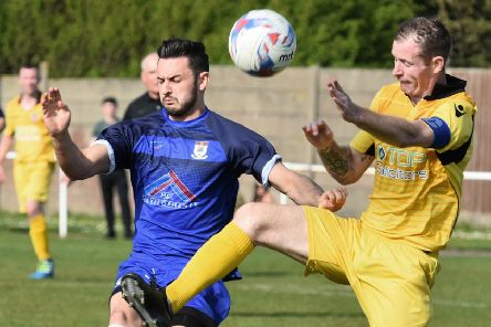 Squires Gate's Ryan Riley battles for the ball      Picture: Albert Cooper