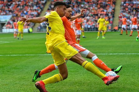James Hill battles for the ball with Blackpool's Nya Kirby