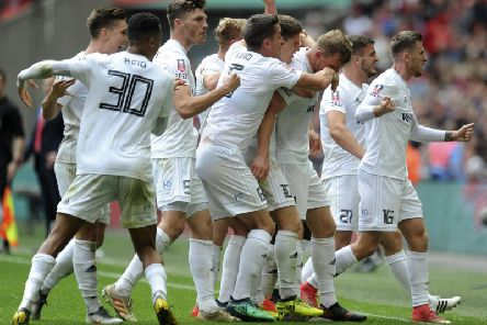 The AFC Fylde team celebrate Danny Rowe's goal against Leyton Orient in the FA Trophy Final at Wembley