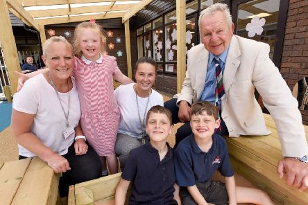 Sir Bill Beaumont with pupils at the playground opening
