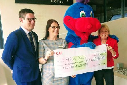 Kath Hands (second left) and her colleagues at Dalmeny Hotel, in St Annes, handing over a cheque for 2,501  for UK Sepsis Trust.