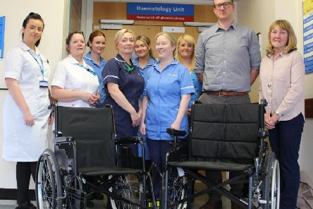 Hilary and Paul Stanyon, far right, with staff from the haematology ward at Blackpool Victoria Hospital