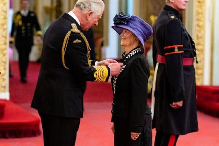 Dr Judith Poole receiving her MBE from Prince Charles