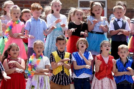 Staff and pupils at Kincraig Primary School celebrate the Queen's reign by having a tea party and performing songs for parents