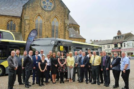 Celebrating the launch of the new buses