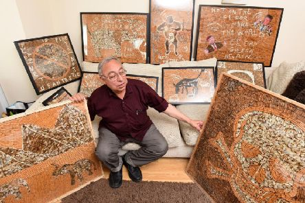 Negweny with some of the artwork he intends to display