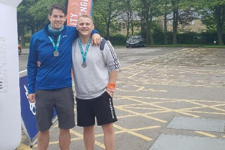 Robert McLeod (left) and Gavin Goulds after completing the overnight fundraising hike in the Peak District