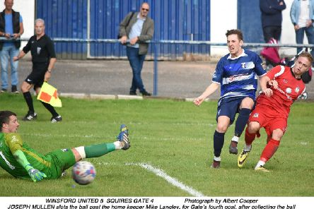 Joey Mullen scores for Squires Gate in the nine-goal thriller at Winsford   Picture: ALBERT COOPER