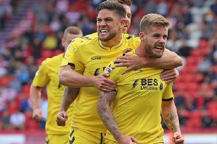 Conor McAleny celebrates his first league goal for Fleetwood in 16 months