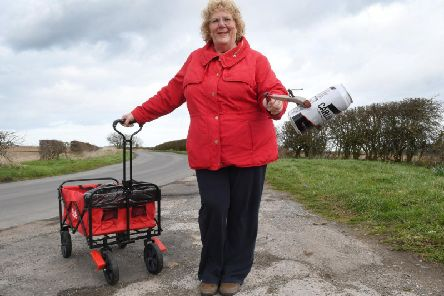 Lisa Crosier is able to continue with her litter picking around Bempton, thanks to local builder Craig Ramsden, who has bought her a new trolley.