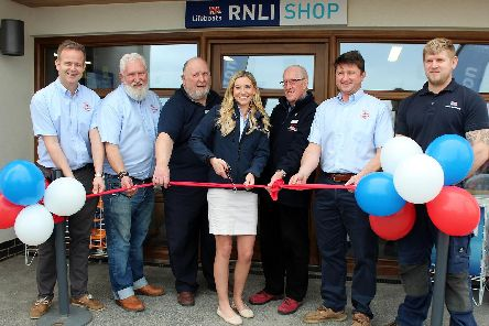 Amanda Woods and some of the Bridlington lifeboat crew cut the ribbon to open the station to the public.