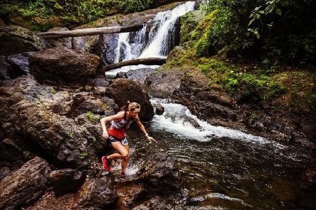 Photo ' Holly Page clambering over a waterfall on the last day of this challenging race (cr�dit�:'@greenmediacr) ' there are other photos available at https://iancorless.org/2019/02/15/the-'coastal-challenge-2019-tcc2019-day-6/