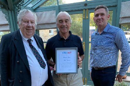Stan Ternent receives his award from Peter Pike and Liam Hallinan