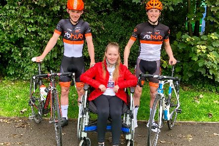 Noah (left) with his sister Evie and fellow cyclist Matthew (right)....