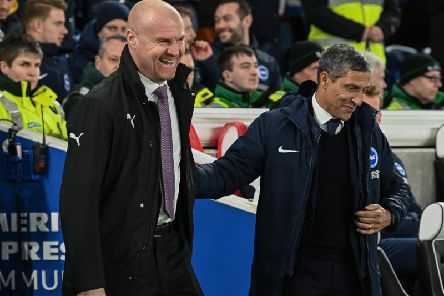Burnley manager Sean Dyche (left) and Brighton and Hove Albion boss Chris Hughton