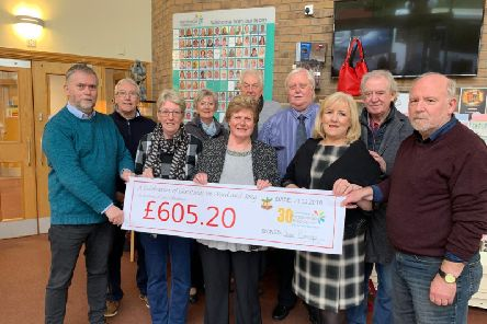 Friends and relatives of Tony Cummings present a cheque to Pendleside Hospice after a concert was held in his memory.