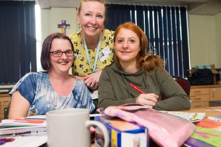 Parents get to grips with their studies as part of a new course at St Augustine's RC Primary School in Burnley.
