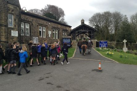 The pupils make their way to church