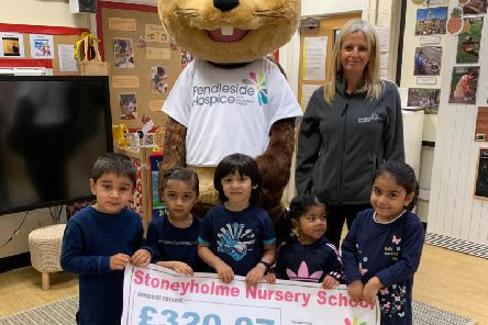 Stoneyholme Nursery School pupils making their donation of 320.07 to Pendleside Hospice.