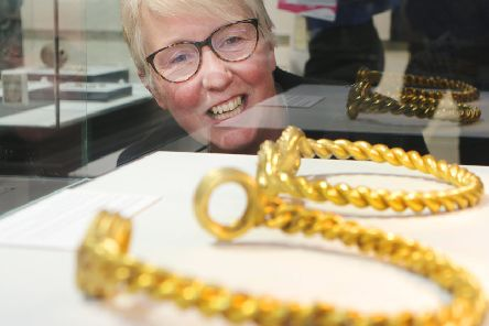 Museum manager Ros Westwood MBE with the golden torcs.