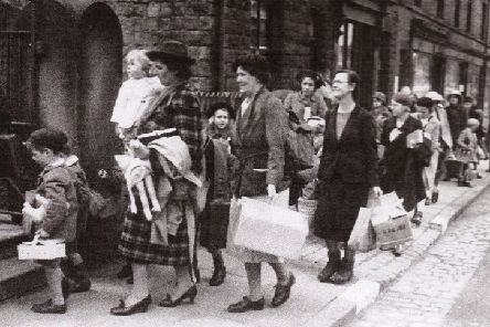 Guernsey evacuees arriving in Disley - with Rosalind Brelsford held by her mother at the front