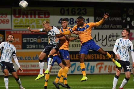Mansfield's Krystian Pearce heads wide.