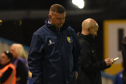 Mansfield's manager John Dempster looks on after his side concede another goal'.