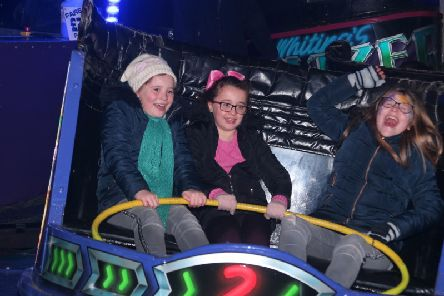 Squeals of delight from Chloe Bramley, Amy Challenger and Ella Bramley as they ride the waltzer.