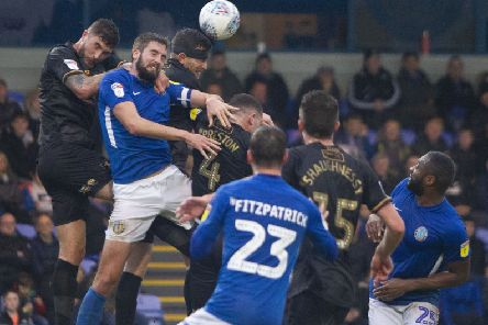 First half action between Macclesfield and Mansfield.