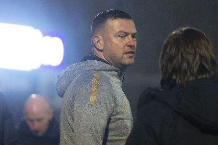 Mansfield manager John Dempster during his side's visit to Macclesfield.