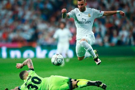 MADRID, SPAIN - MAY 04:  Nicolas Otamendi of Manchester City makes a tackle on Jese of Real Madrid  during the UEFA Champions League semi final, second leg match between Real Madrid and Manchester City FC at Estadio Santiago Bernabeu on May 4, 2016 in Madrid, Spain.  (Photo by Gonzalo Arroyo Moreno/Getty Images)