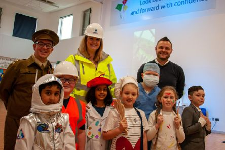 Mansfield MP Ben Bradley with staff and pupils from Flying High Academy, who dressed up for careers day