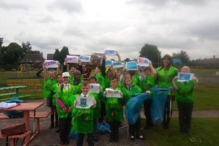 Pupils from Wainwright Academy taking part in International Clean Up day at Ladybrook Park, Mansfield.