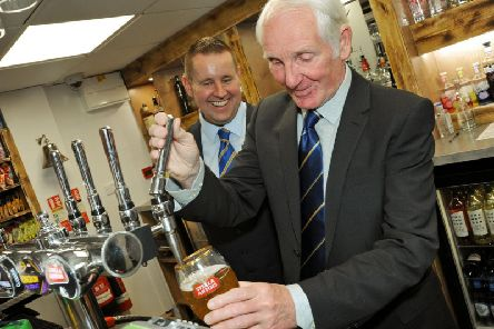 Stags legend Sandy Pate, pulls a pint at the newly refurbish Sandy's Bar and Kitchen with bar manager, Jonathan Redfearn.