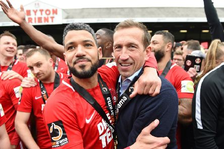LONDON, ENGLAND - APRIL 27:  Jobi McAnuff of Leyton Orient celebrates with Justin Edinburgh manager of Leyton Orient as they win the title after the Vanarama National League match between Leyton Orient and Braintree Town at Brisbane Road on April 27, 2019 in London, England. (Photo by Harriet Lander/Getty Images)