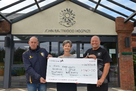 Cheque presentation to John Eastwood Hospice, money raised from charity football tournament in memory of lifelong Stags fan Michael Lojek, pictured receiving the cheque is Hospice Trust Manager Diane Humphreys with John Watson and David Butler